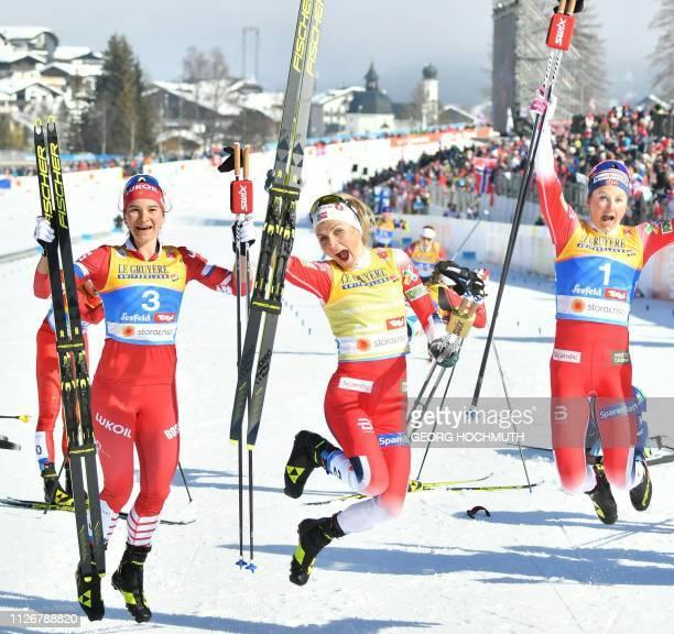 TOPSHOT Third placed Russia's Natalia Nepryaeva winner Norway's Therese Johaug and third placed Norway's Ingvild Flugstad Oestberg react after the...