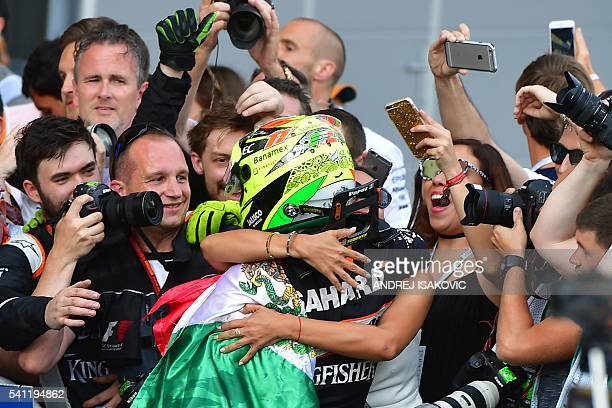 Third placed Sahara Force India F1 Team's Mexican driver Sergio Perez celebrates after the European Formula One Grand Prix at the Baku City Circuit...