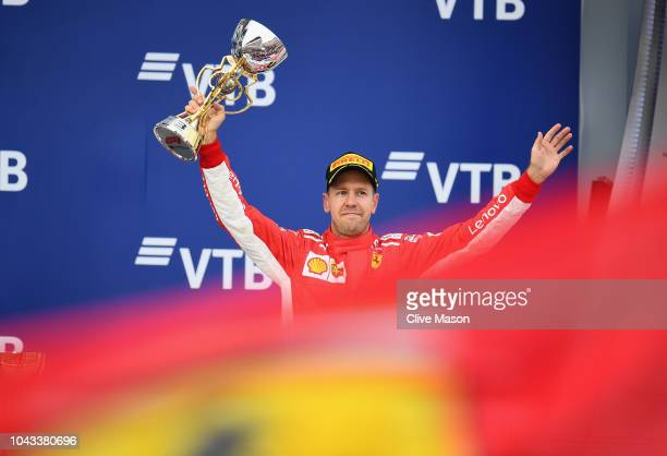 Third placed Sebastian Vettel of Germany and Ferrari celebrates on the podium during the Formula One Grand Prix of Russia at Sochi Autodrom on...