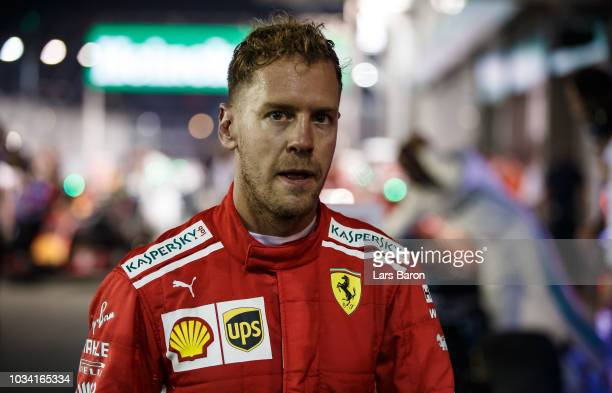 Third placed Sebastian Vettel of Germany and Ferrari looks dejected in parc ferme during the Formula One Grand Prix of Singapore at Marina Bay Street...