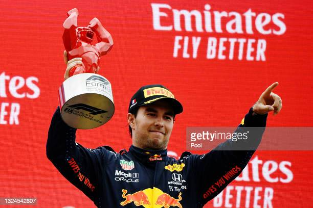 Third placed Sergio Perez of Mexico and Red Bull Racing celebrates on the podium during the F1 Grand Prix of France at Circuit Paul Ricard on June...