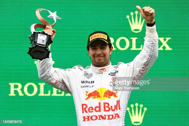 Third placed Sergio Perez of Mexico and Red Bull Racing celebrates on the podium during the F1 Grand Prix of Turkey at Intercity Istanbul Park on...