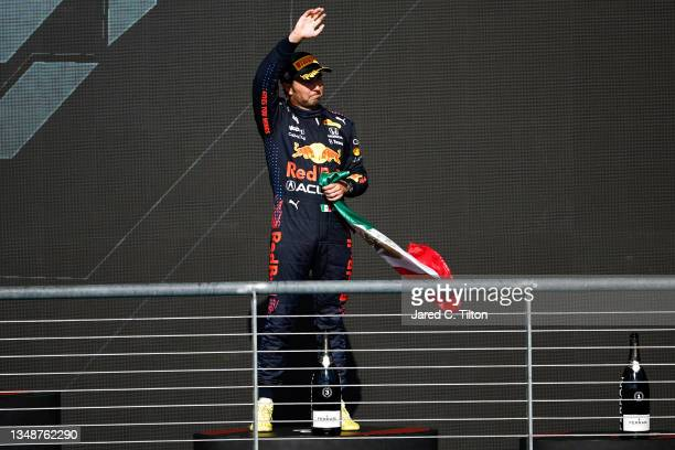 Third placed Sergio Perez of Mexico and Red Bull Racing celebrates on the podium during the F1 Grand Prix of USA at Circuit of The Americas on...