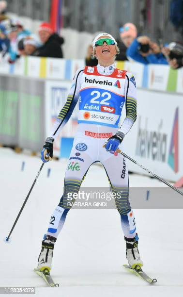 Third placed Sweden's Frida Karlsson reacts after the CrossCountry Ladies 30km Mass Start Free event at the FIS Nordic World Ski Championships on...