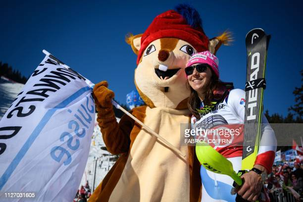 Third placed Switzerland's Wendy Holdener celebrates with the mascot after competing in the two rounds of the Women's Alpine Combined race during the...