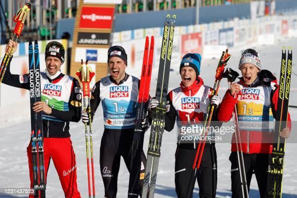 Third placed team, Austria's Johannes Lamparter , Austria's Lukas Klapfer , Austria's Mario Seidl and Austria's Lukas Greiderer celebrate after the...