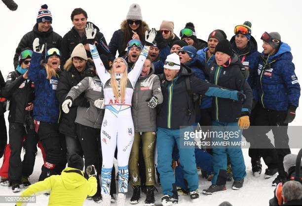 Third placed US' Lindsey US Lindsey Vonn celebrates with coaches and family members after the Women's Downhill event of the 2019 FIS Alpine Ski World...
