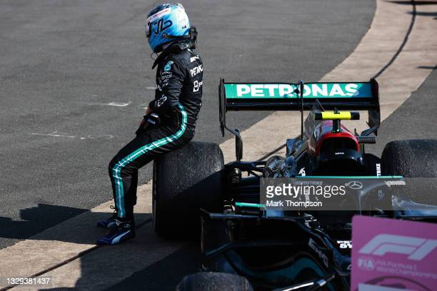Third placed Valtteri Bottas of Finland and Mercedes GP celebrates in parc ferme during the F1 Grand Prix of Great Britain at Silverstone on July 18,...