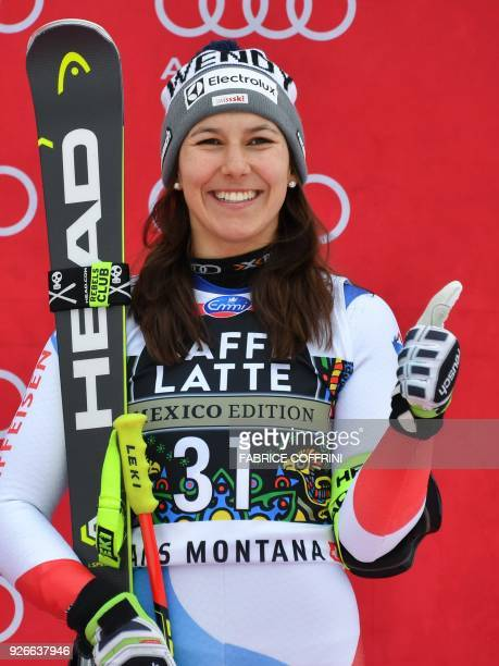 Third placed Wendy Holdener of Switzerland gestures during the podium ceremony of the Women's SuperG at the FIS Alpine Ski World Cup on March 3 2018...