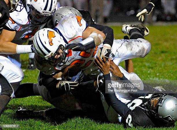Third quarter action as Briar Woods Michael Brownlee dives over several Dominion players for more yardage on November 5 2010