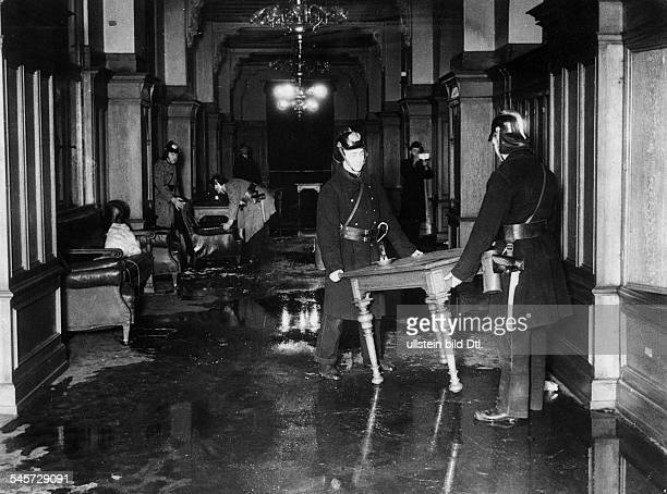 Third Reich burníng of the Reichstag on night of 27 to Firefighters clearing up a waterdamaged conference room after finishing firefight