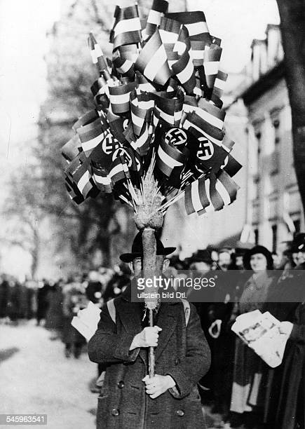 Third Reich opening of the Reichstag 'Day of Potsdam' Vendor of flags NS svastika and old imperial flag oÌf the Reich