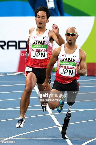 Third runner Tomoki Tagawa touches to final runner Atsushi Yamamoto of Japan in the Men's 4x100m Relay T4247 Final duirng day 5 of the 2016 Rio...