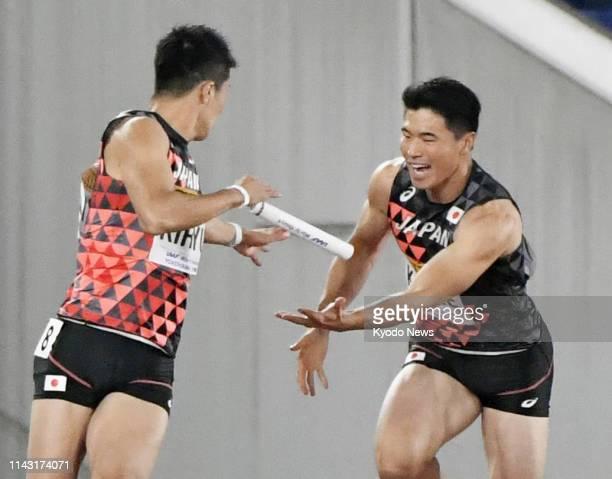 Third runner Yuki Koike and Yoshihide Kiryu mess up the final baton handoff in the men's 4x100 heats at the IAAF World Relays in Yokohama, near...