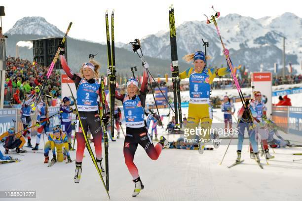 Third second Ingrid Landmark Tandrevold of Norway first placed Tiril Eckhoff of Norway and third placed Hanna Oeberg of Sweden celebrates behind the...