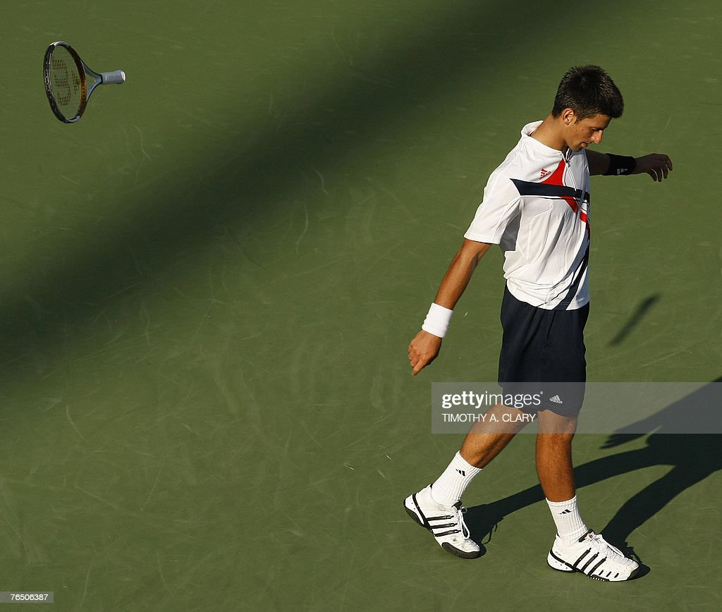Third seed Novak Djokovic of Serbia throws his racquet in frustration during his fourth round match against twenty-third-seeded Argentinian Juan Monaco at the US Open Tennis Championships at the USTA National Tennis Center in Flushing Meadows, New York, 04 September 2007. AFP PHOTO/Timothy A. CLARY