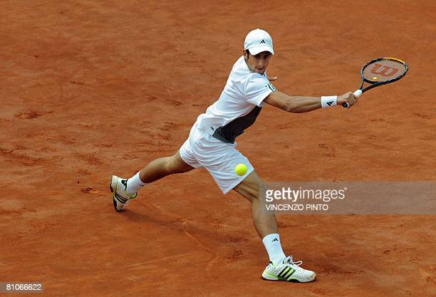 Third seed Serbian Novak Djokovic returns a backhand to Switzerland's Stanislas Wawrinka during the final of the ATP Tennis Open in Rome on May 11,...