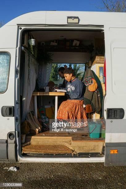 Third year students at Falmouth University, Max Richmond and Yasmine Fosu do university course work in their van on January 07, 2021 in Falmouth,...