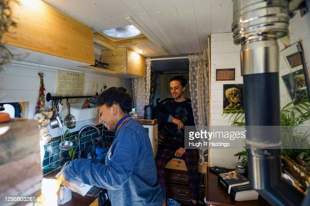 Third year students at Falmouth University, Max Richmond and Yasmine Fosu make tea in their van on January 07, 2021 in Falmouth, England. Max, 21...