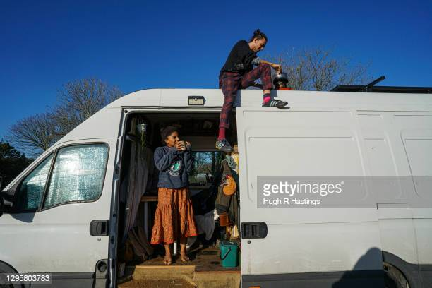 Third year students at Falmouth University, Max Richmond and Yasmine Fosu undertake repairs to their van on January 07, 2021 in Falmouth, England....