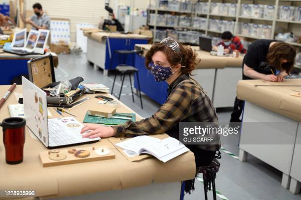 Third year students on the Special Effects Model Making for Film and Television course wear face coverings to help mitigate the spread of the novel...