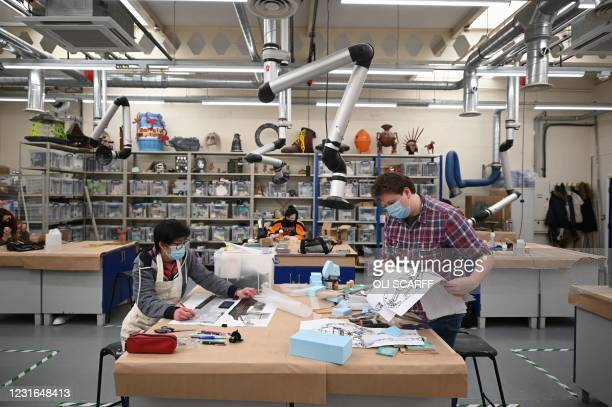 Third year students studying model making for TV and film work in a workshop at the University of Bolton in Bolton, northwest England, on March 11,...