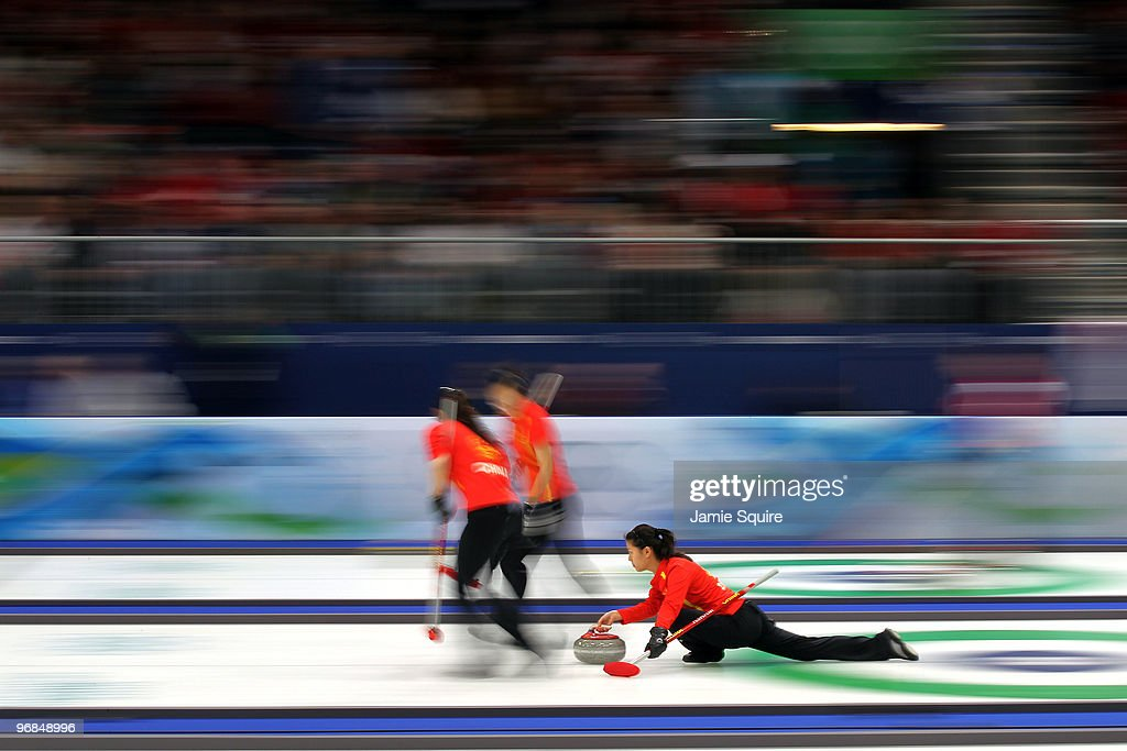 Third Yin Liu of China delivers as Qingshuang Yue and Yan Zhou sweep during the women's curling round robin game against Denmark on day 7 of the Vancouver 2010 Winter Olympics at Vancouver Olympic Centre on February 18, 2010 in Vancouver, Canada.