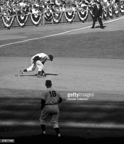 Thirdbaseman Andy Carey of the New York Yankees grabs the line drive off the bat of Gil Hodges o fthe Brooklyn Dodgers as pitcher Don Larsen looks on...