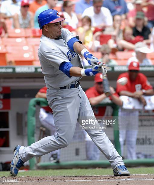 Thirdbaseman Aramis Ramirez, of the Chicago Cubs, breaks his bat as he singles in the first inning of a game on July 23, 2006 against the Washington...