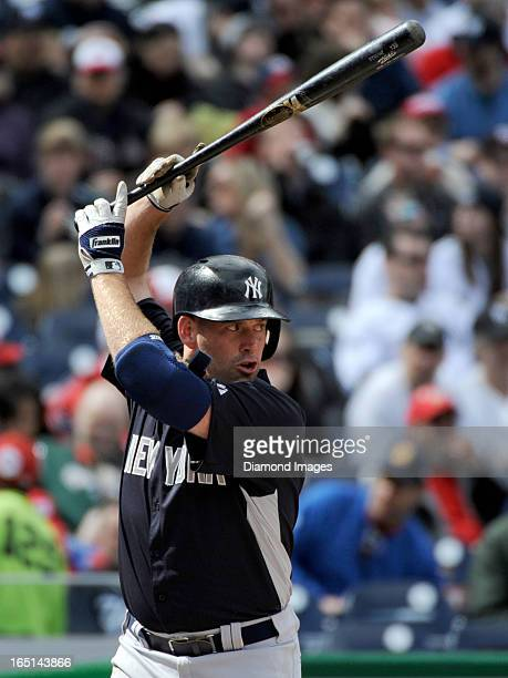 Thirdbaseman Kevin Youkilis of the New York Yankees holds his bat high above his head as he awaits the next pitch during the top of the first inning...