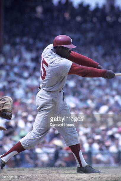 Thirdbaseman Richie Allen of the Philadelphia Phillies swings at a pitch during a game in 1964 against the Cincinnati Reds at Crosley Field in...