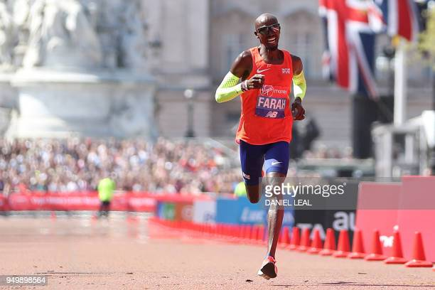 Thirdplaced Britain's Mo Farah crosses the finish line of the elite men's race of the 2018 London Marathon in central London on April 22 2018