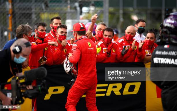 Thirdplaced Charles Leclerc of Monaco and Ferrari celebrates with team members in parc ferme during the F1 Grand Prix of Great Britain at Silverstone...