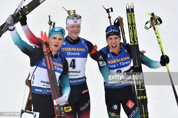 Thirdplaced French Emilien Jacquelin winner Norwegian Johannes Thingnes Boe and secondplaced French Quentin Fillon Maillet react after crossing the...