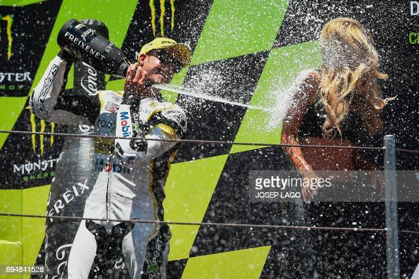 Thirdplaced GarXpert Interwetten's Swiss rider Thomas Luthi sprays cava on the podium of the Moto2 race of the Catalunya Grand Prix at the Montmelo...