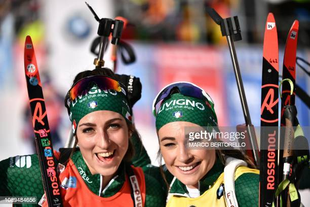 Thirdplaced Italy's Lisa Vittozzi and winner Italy's Dorothea Wierer celebrate after the women's 10km pursuit event of the IBU Biathlon World Cup in...