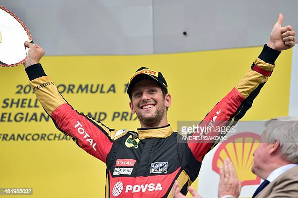 Third-placed Lotus F1 Team's French driver Romain Grosjean celebrates on the podium at the Spa-Francorchamps circuit in Spa on August 23 after the...