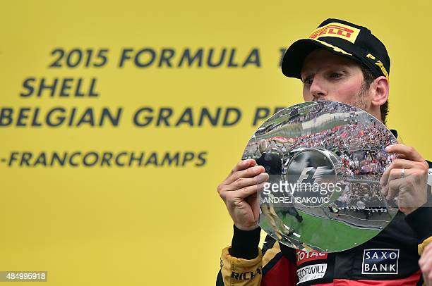 Third-placed Lotus F1 Team's French driver Romain Grosjean celebrates with his trophy on the podium at the Spa-Francorchamps circuit in Spa on August...