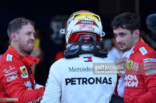 Thirdplaced Mercedes' British driver Lewis Hamilton chats with secondplaced Ferrari's German driver Sebastian Vettel and sixthplaced Ferrari's...