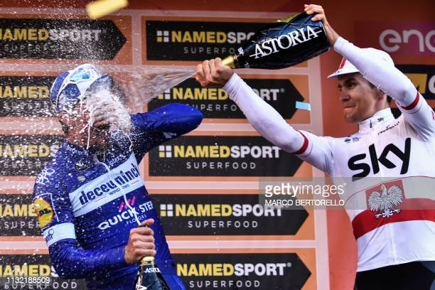 Thirdplaced Poland's Michal Kwiatkowski sprays champagne over race winner France's Julian Alaphilippe as they celebrate on the podium after the...