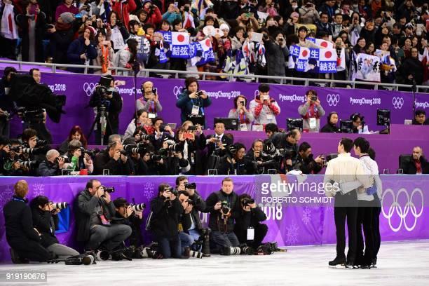 TOPSHOT Thirdplaced Spain's Javier Fernandez winner Japan's Yuzuru Hanyu and secondplaced Japan's Shoma Uno pose for photographers during the venue...