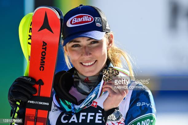 Third-placed US Mikaela Shiffrin celebrates on the podium during the medal ceremony after competing in the first and second run of the Women's Slalom...