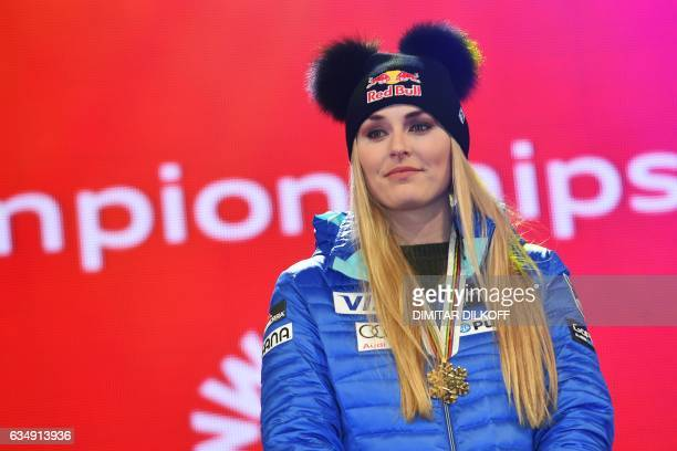 Thirdplaced US skier Lindsey Vonn pose on the podium after the women's downhill race at the 2017 FIS Alpine World Ski Championships in St Moritz on...