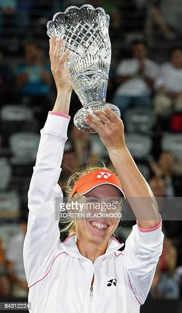 Third-seeded Elena Dementieva of Russia displays her trophy after defeating second-seeded compatriot Dinara Safina in the women's final of the Sydney...
