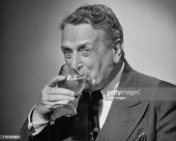 thirsty businessman - 20世紀 ストックフォトと画像