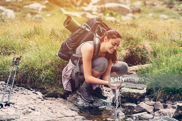 Thirsty hiker enjoying the water