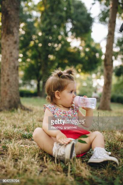 thirsty little explorer - one baby girl only stock pictures, royalty-free photos & images