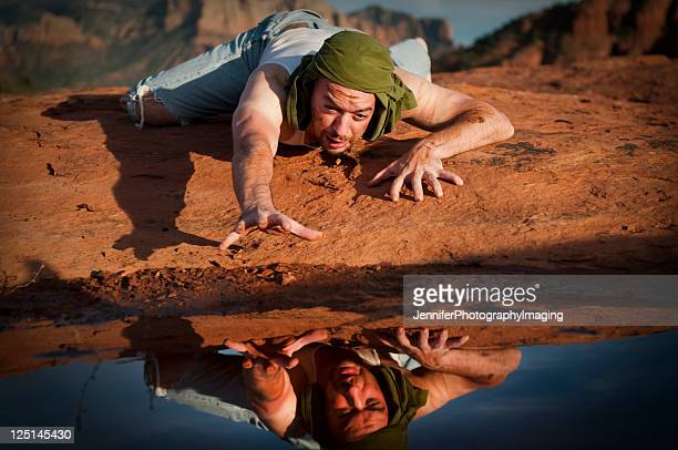 thirsty man in the desert - thirsty stock pictures, royalty-free photos & images