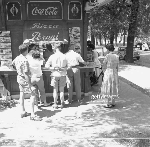 Thirsty people buying a drink at the kiosk in Rome in a very hot day 1958