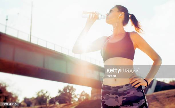 Thirsty woman drinking from water bottle